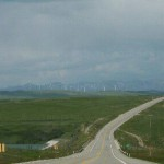 Landscape photograph of wind turbines in the distance.